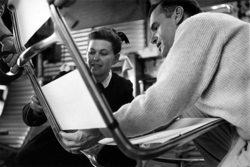 Ray and Charles Eames working in their office